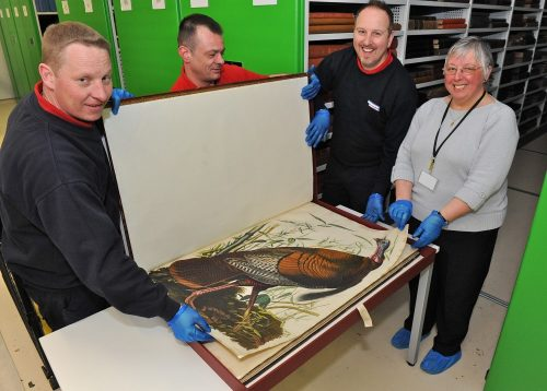Val Thomas, conservation assistant at the library shows a volume of Audubon's Birds of America, worth £8.5m, to the Andrew Porter team